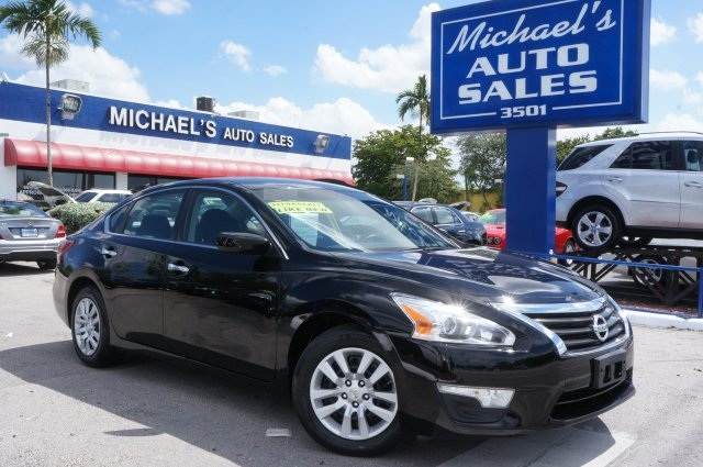 2014 Nissan Altima Black CVT with Xtronic Here it is No games just business Confused about