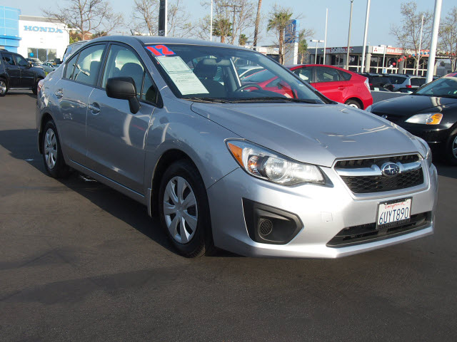 2012 Subaru Impreza Silver AMFM radioCD playerMP3 decoderRadio data systemAir ConditioningRe